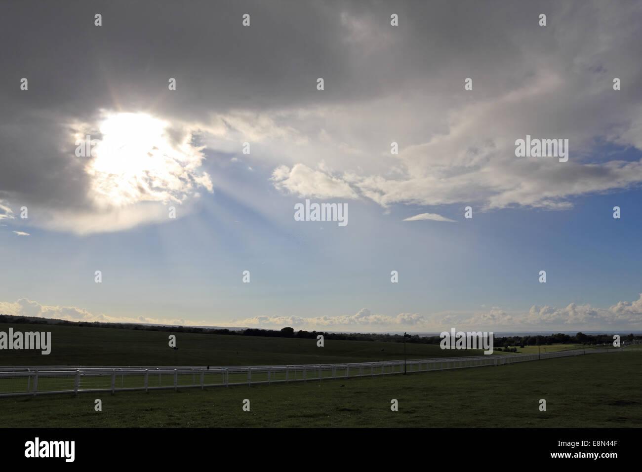 Epsom Downs, Surrey, UK. 11th October 2014. Blue skies alternate with dramatic cumulonimbus rain clouds over Epsom - Stock Image