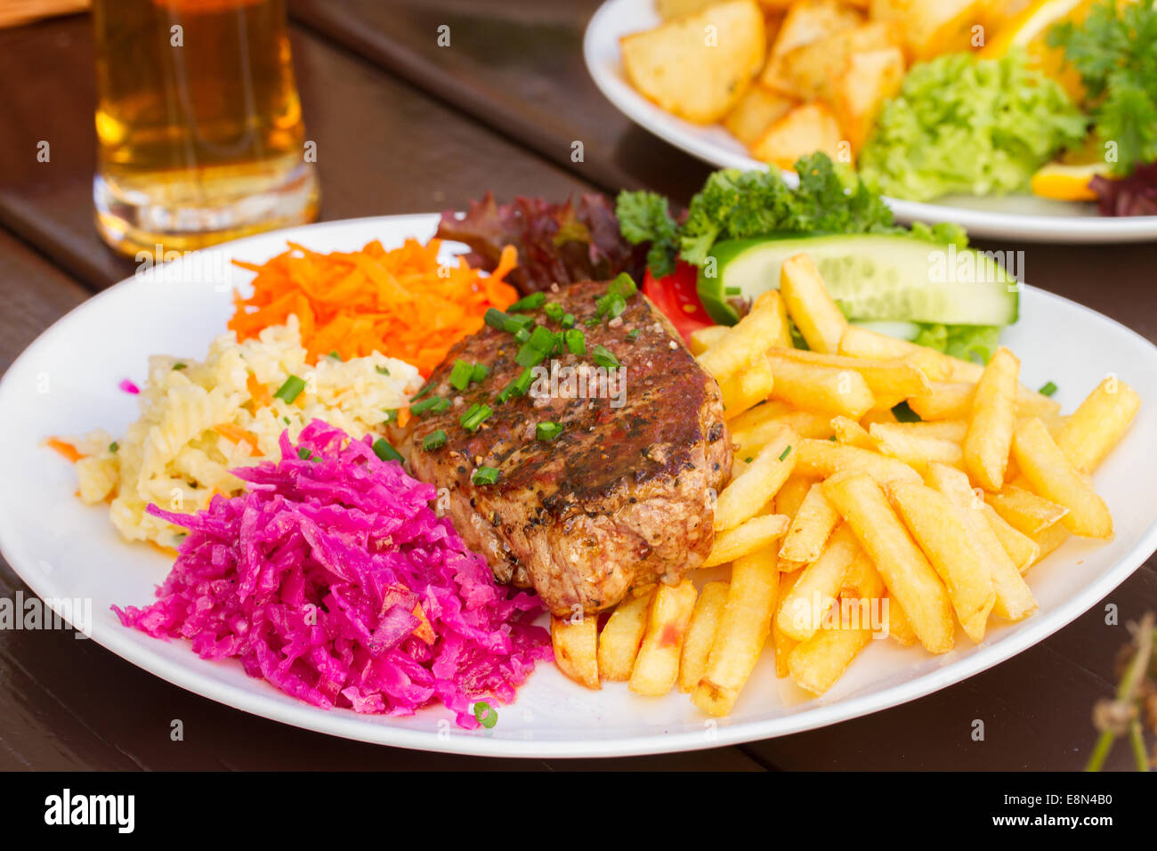 plate of meat steak with garnish - Stock Image