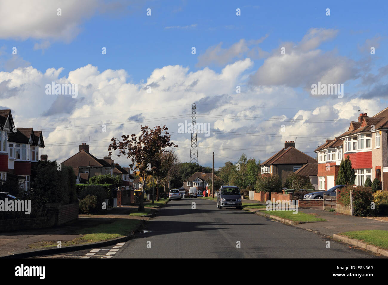 Epsom, Surrey, UK. 11th October 2014. Blue skies alternate with dramatic cumulonimbus rain clouds over this residential - Stock Image