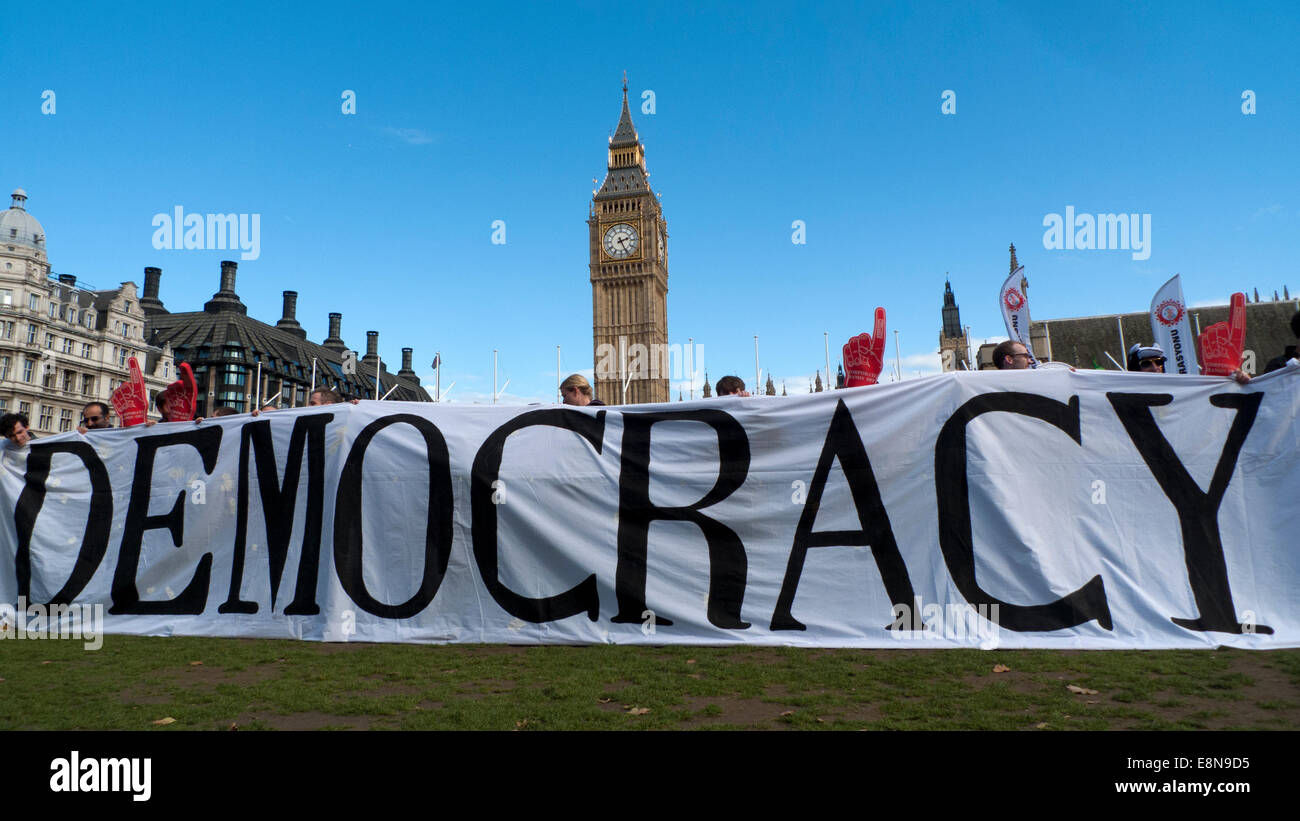 Parliament Square, London UK. 11th October 2014. Demonstrations take place with Anti TTIP banners in Parliament - Stock Image