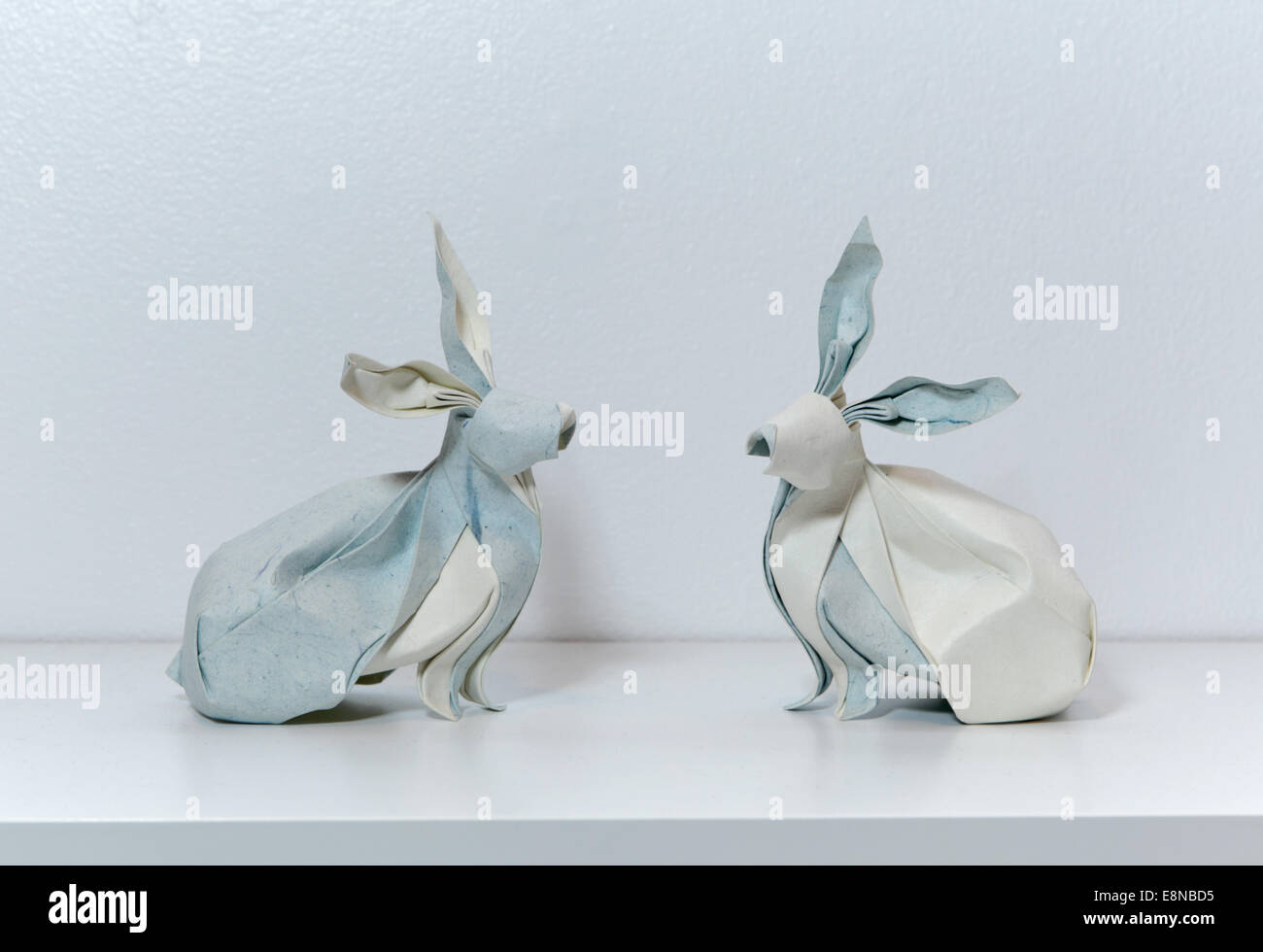 Twin origami rabbits designed and folded by Vietnamese origami artist, Nguyen Hung Cuong - Stock Image