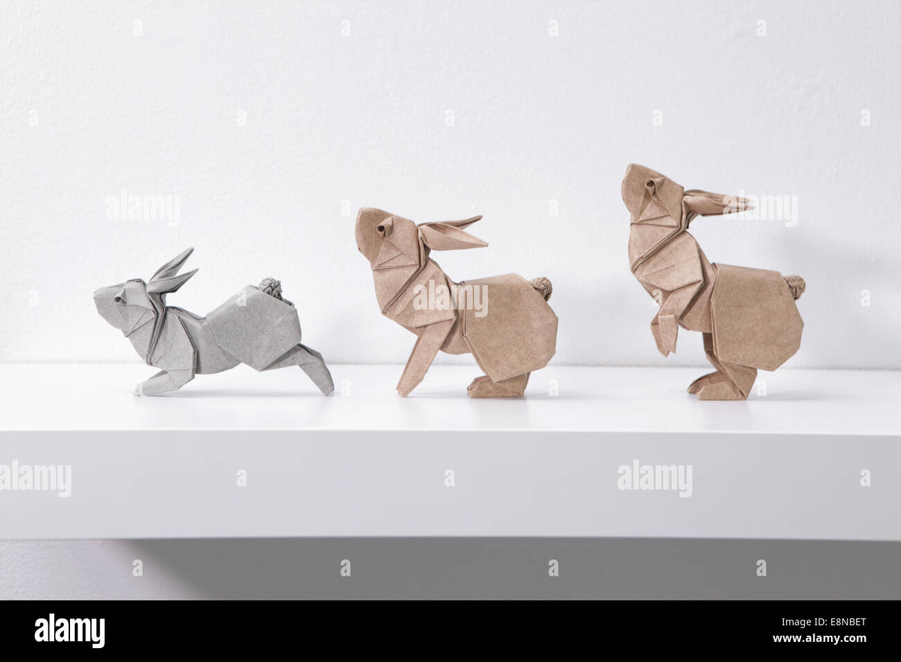 Three origami Rabbits in Motion designed by Ronald Koh, Singapore - Stock Image
