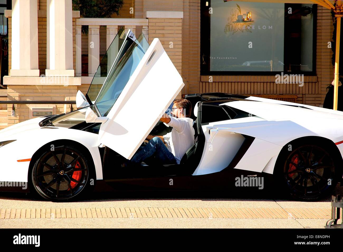 Scott Disick Leaves Barneys New York In Beverly Hills And Drives Off In His  White Lamborghini