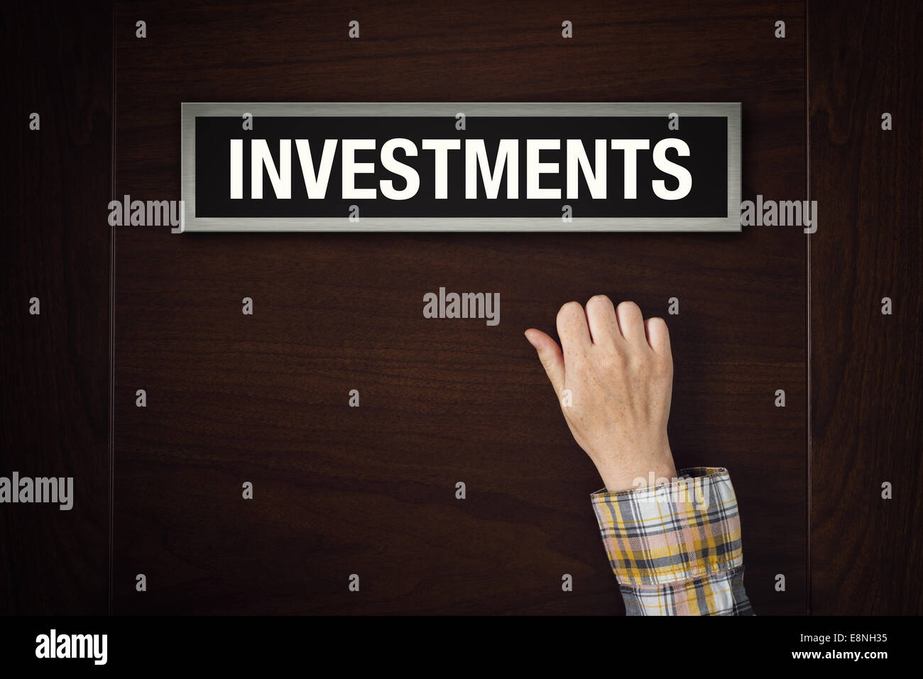 Female hand is knocking on Investments door, conceptual image. - Stock Image