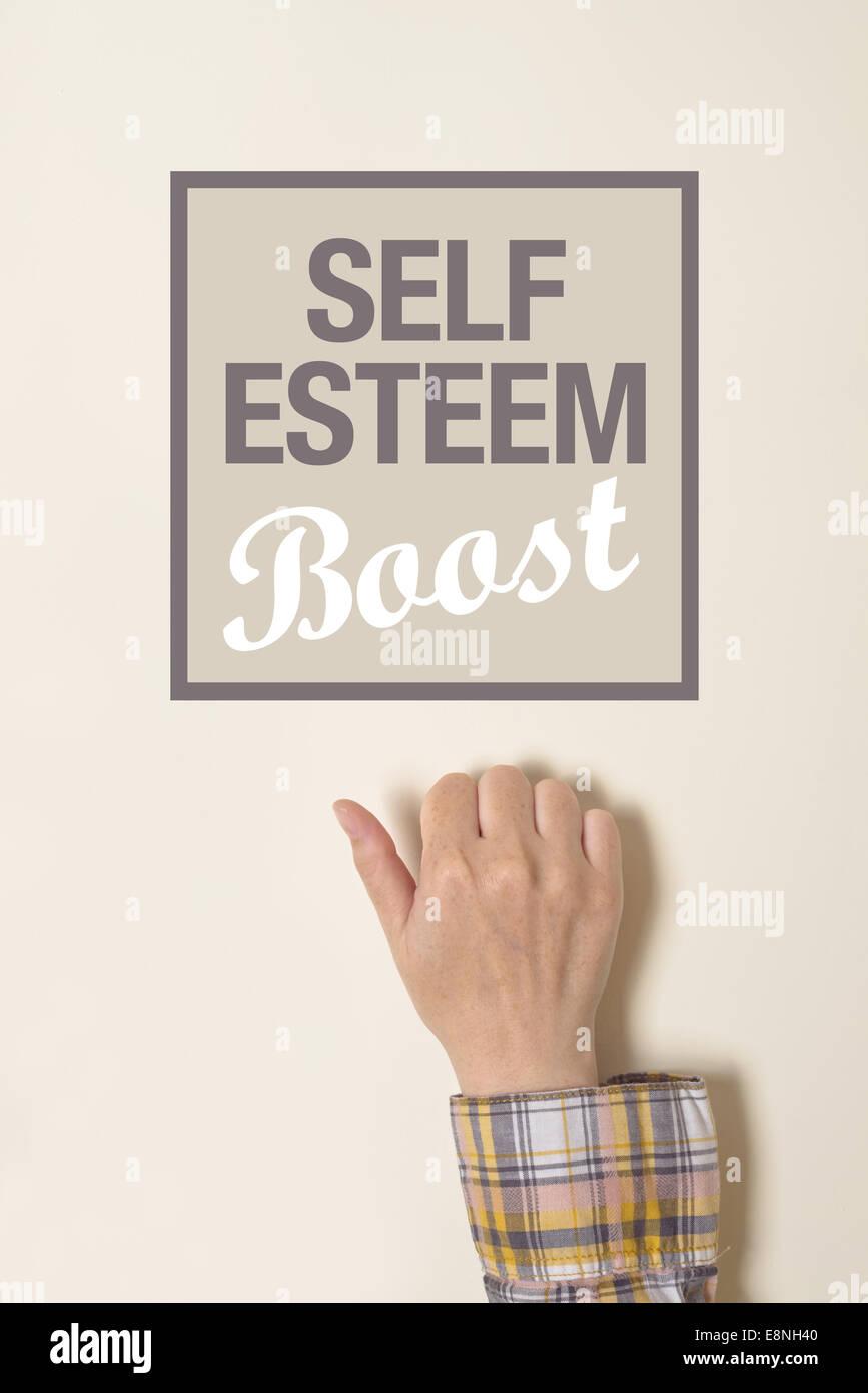 Female hand is knocking on Self-esteem boost door, conceptual image - Stock Image
