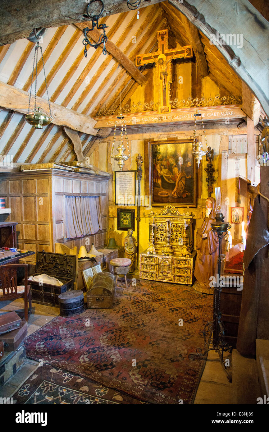 Messy bedroom full of collectibles from Charles Wade, Snowshill Manor, Snowshill, The Cotswolds, Gloucestershire, - Stock Image