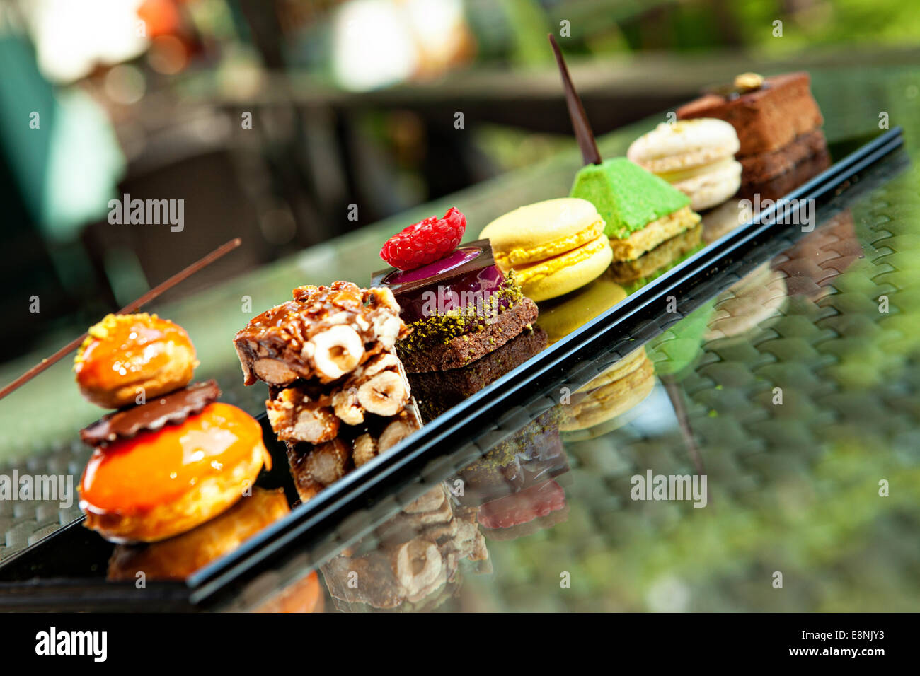 Gorgeous view of different cakes and biscuits, served in outdoors - Stock Image
