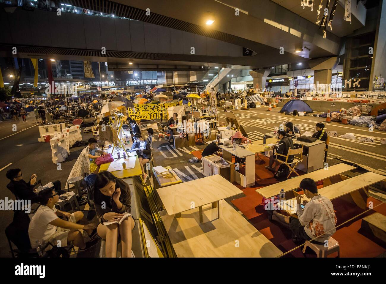 Hong Kong, China. 12th Oct, 2014. Students study on the street during the 15th-day occupy movement outside the chief Stock Photo