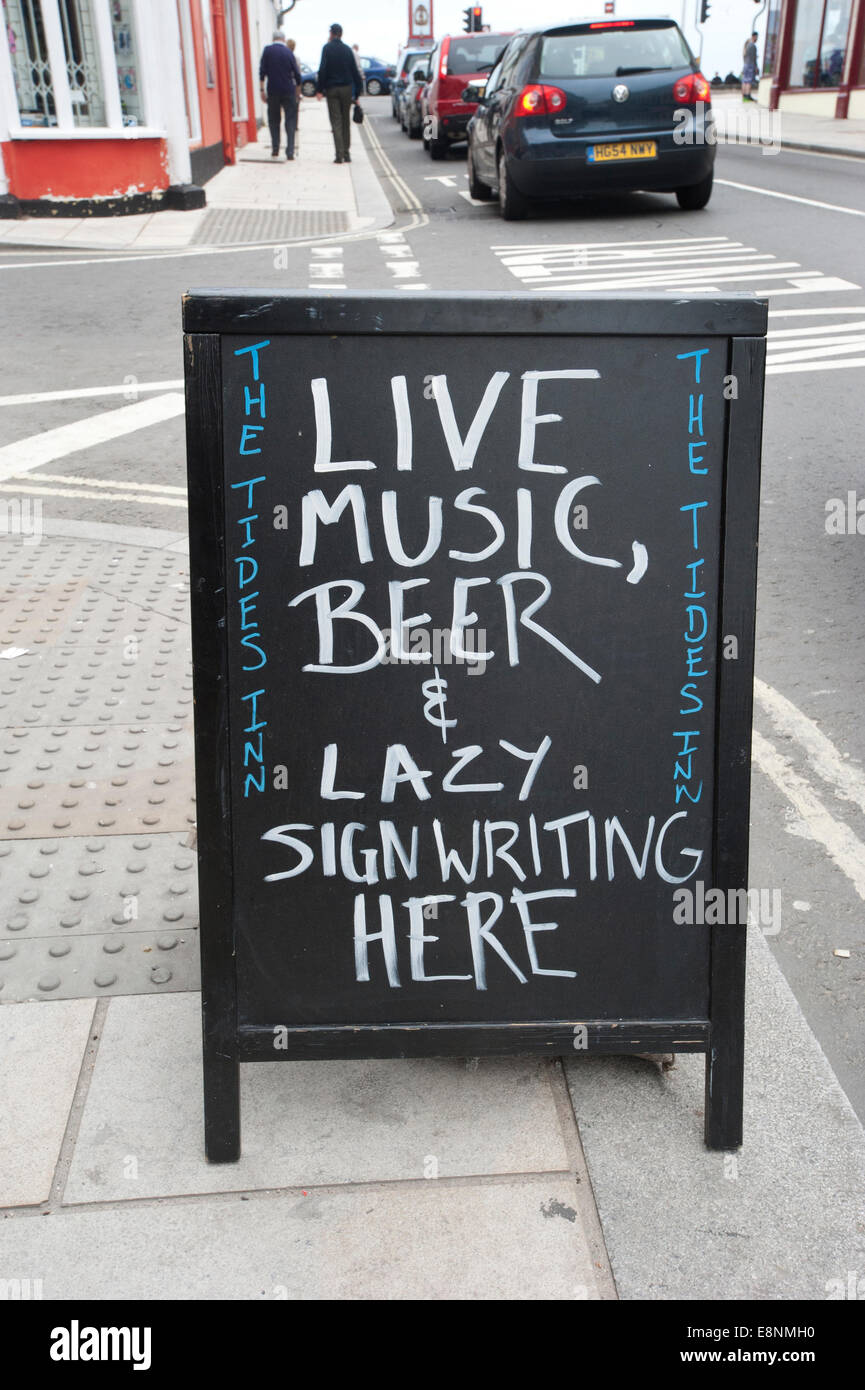 A pub sign written on an 'A' board outside a pub in Weymouth - Stock Image