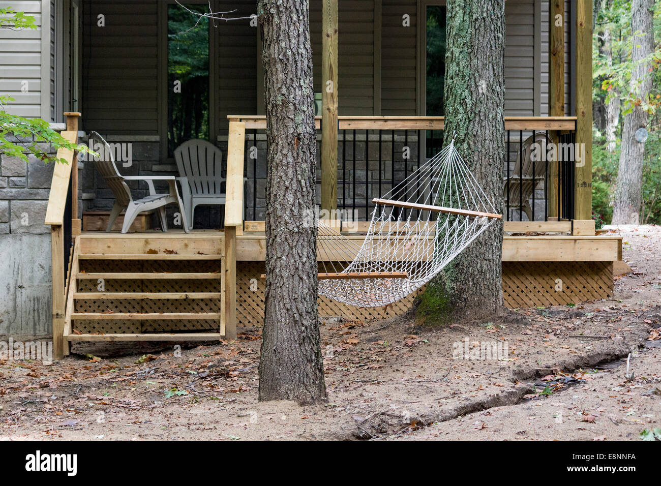 Incredible Hammock Slung Between Two Trees In Front Of A Cottage In Home Interior And Landscaping Mentranervesignezvosmurscom