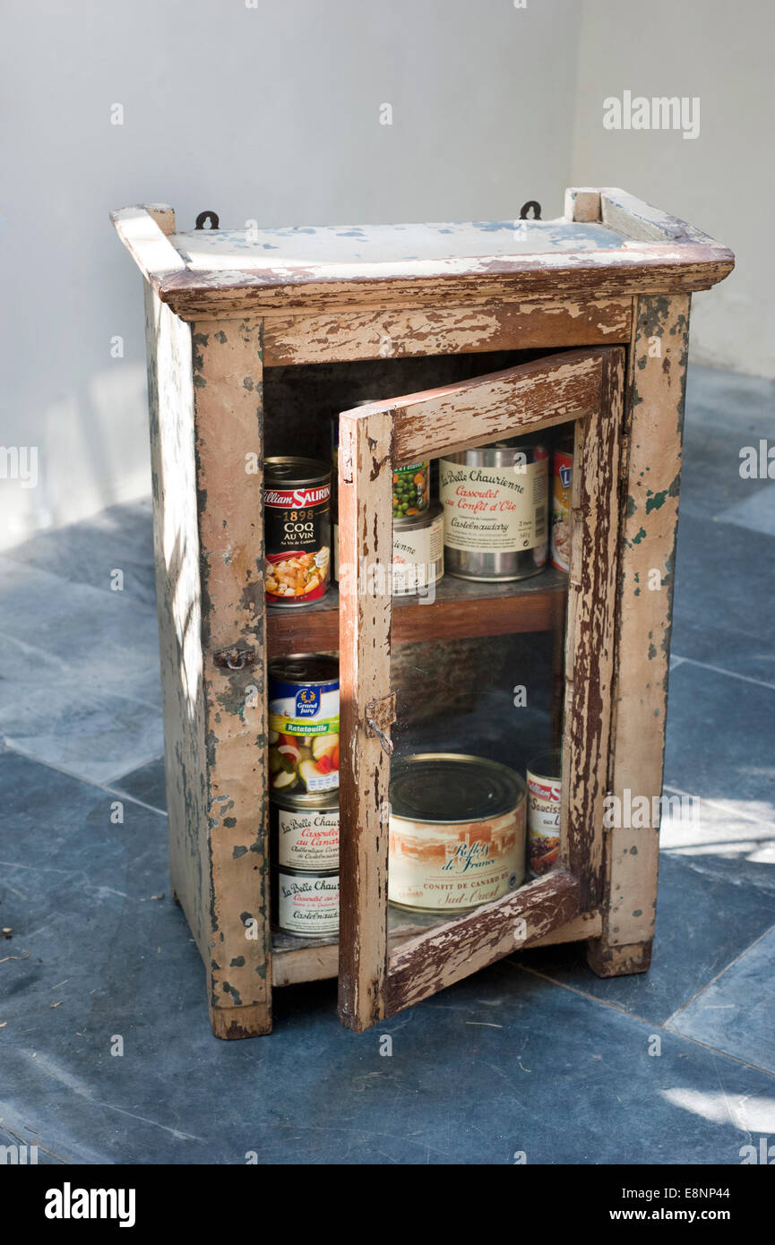 Picture by Roger Bamber : 30 June 2014 : An old battered Indian Tin food cabinet full with Ten tins of French food - Stock Image