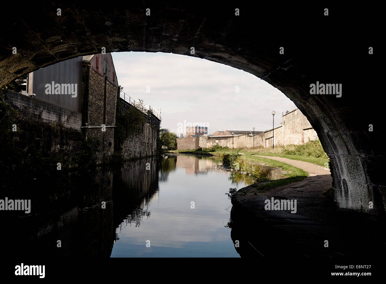 Canal bridge with factories behind in Blackburn - Stock Image
