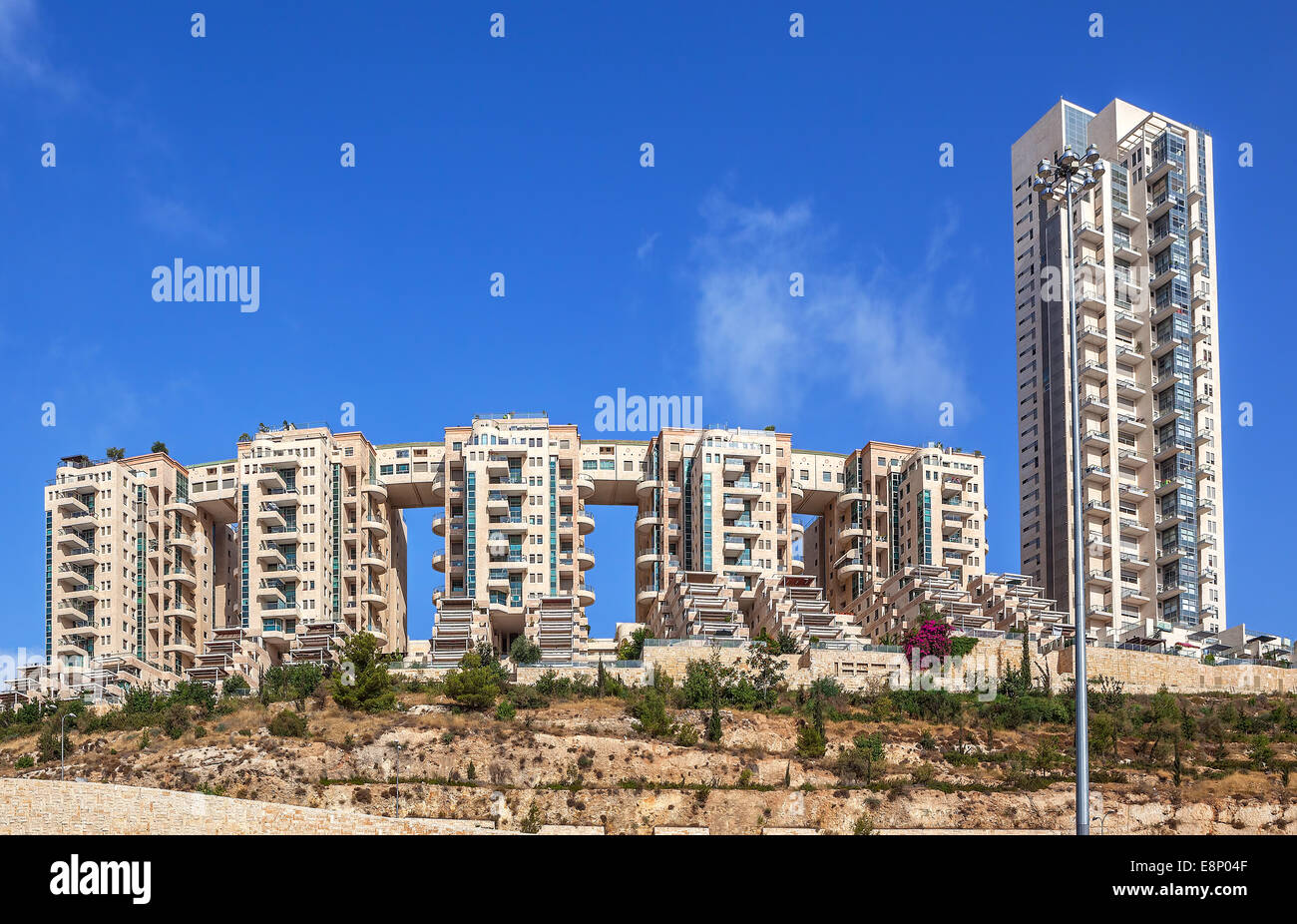 Contemporary residential complex under blue sky in Jerusalem, Israel. - Stock Image