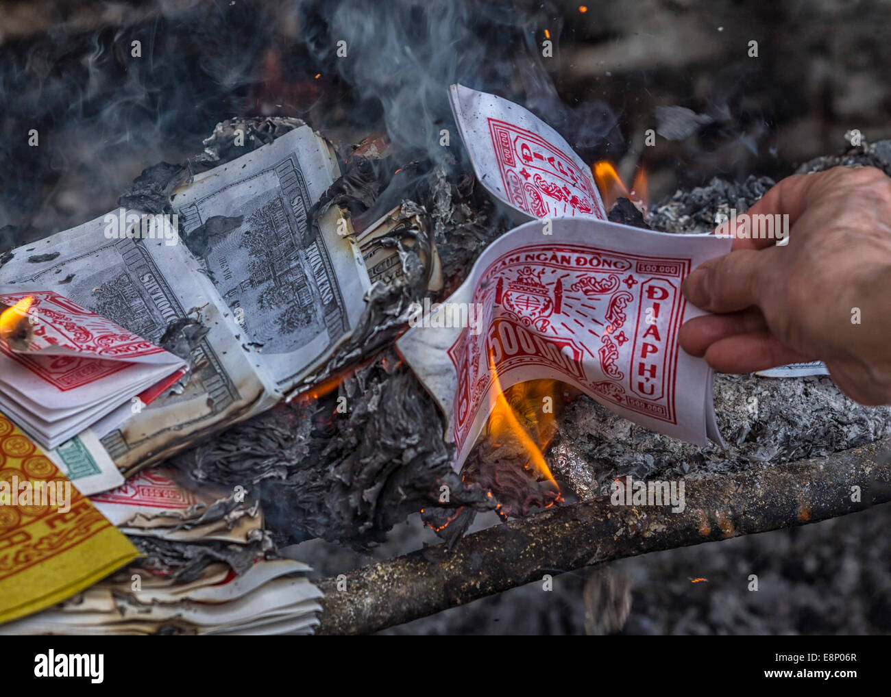 Bundles of money are burned to please the spirits. Stock Photo