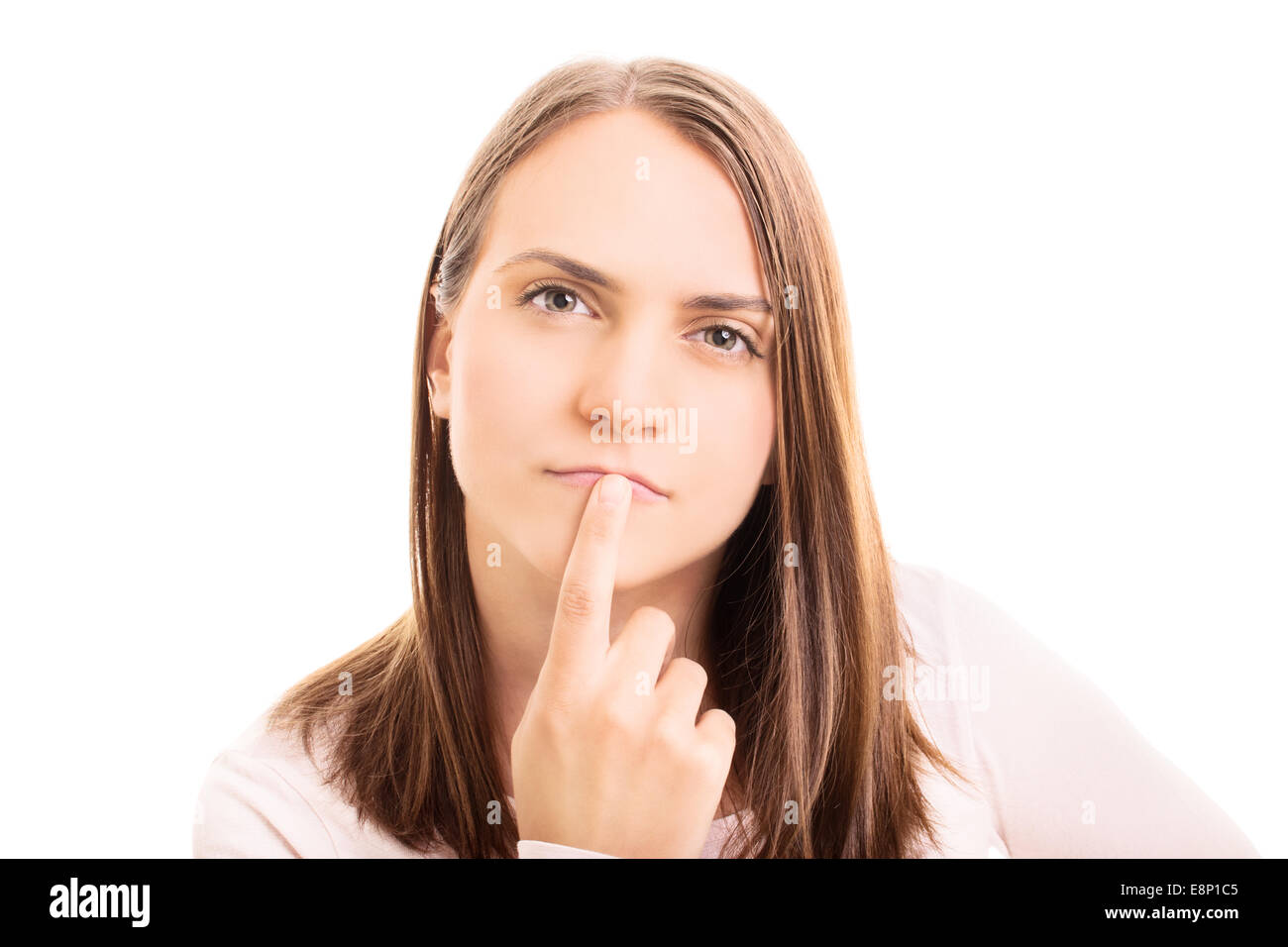 Close-up shot of young girl thinking of something isolated on white background - Stock Image