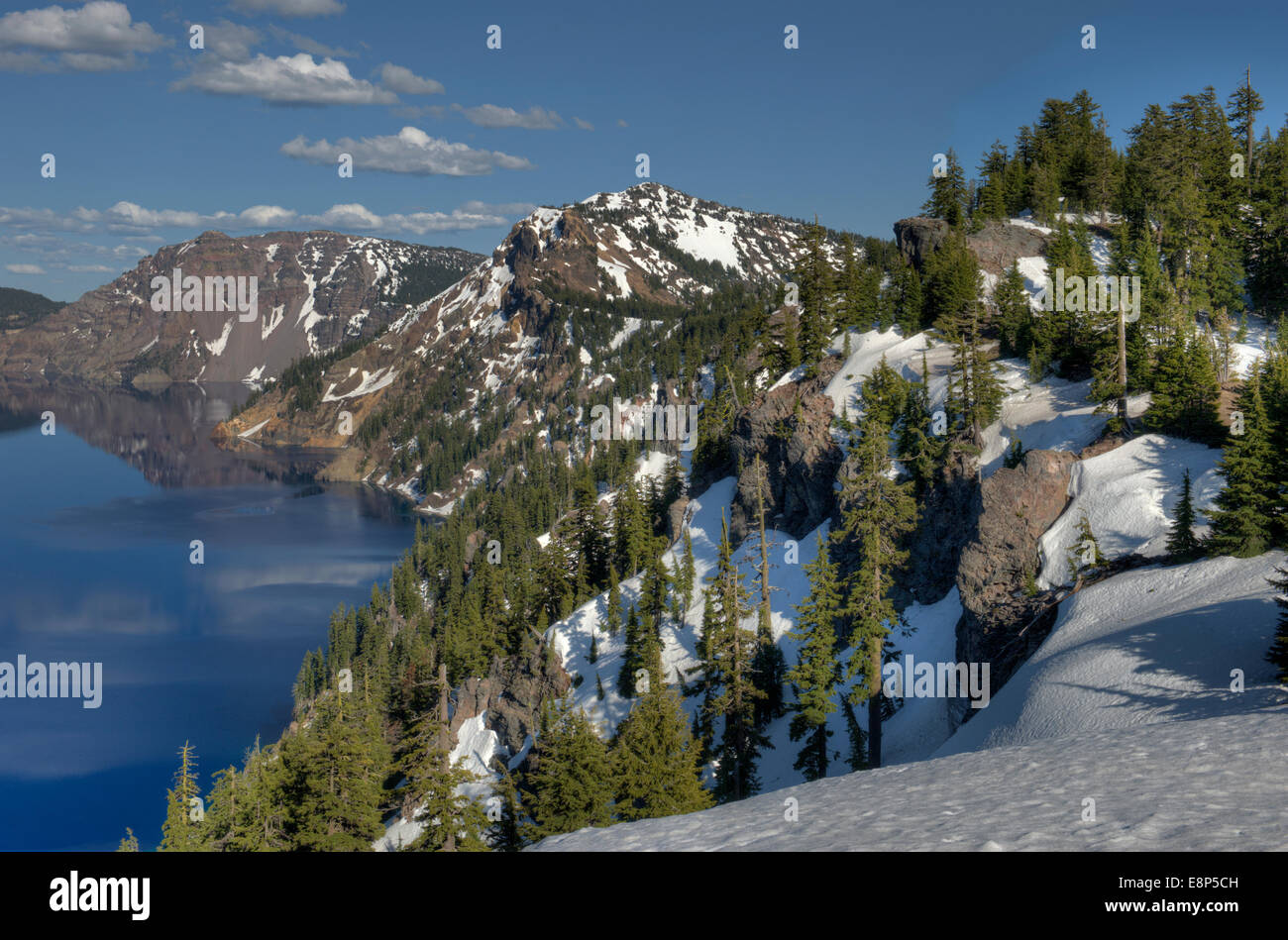 The south rim of Oregon's Crater Lake, as seen from Discovery Point, late spring - Stock Image