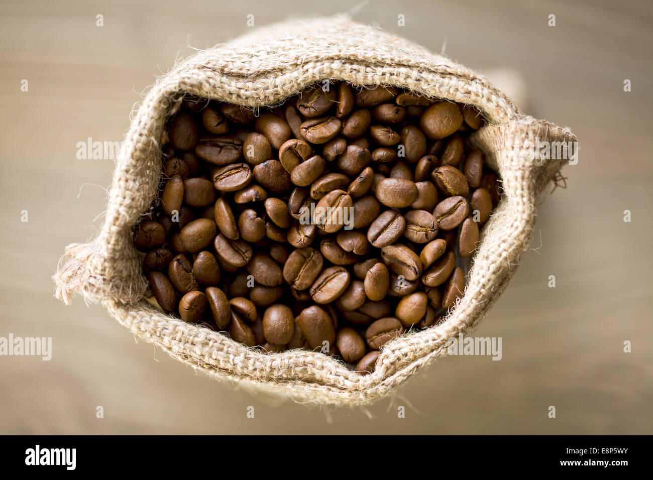 top view of coffee beans in burlap sack - Stock Image