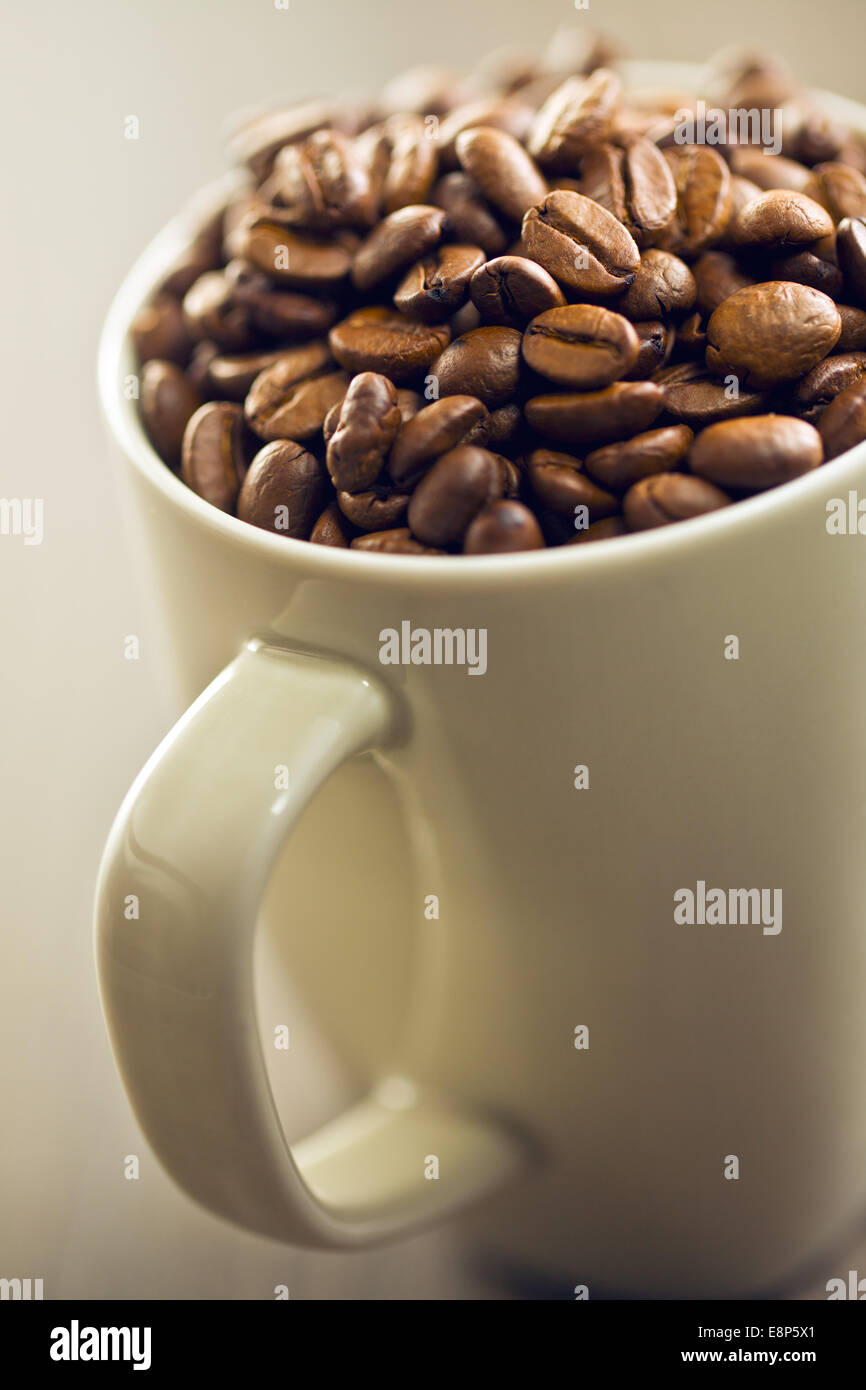 coffee beans in mug - Stock Image