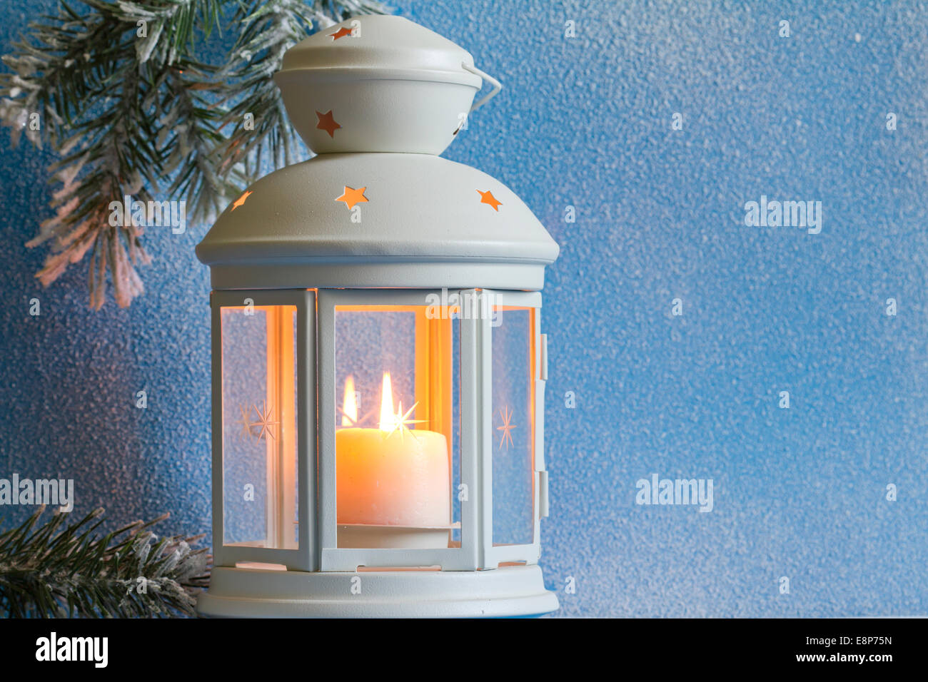 Christmas lantern with snow and tree abstract background closeup - Stock Image