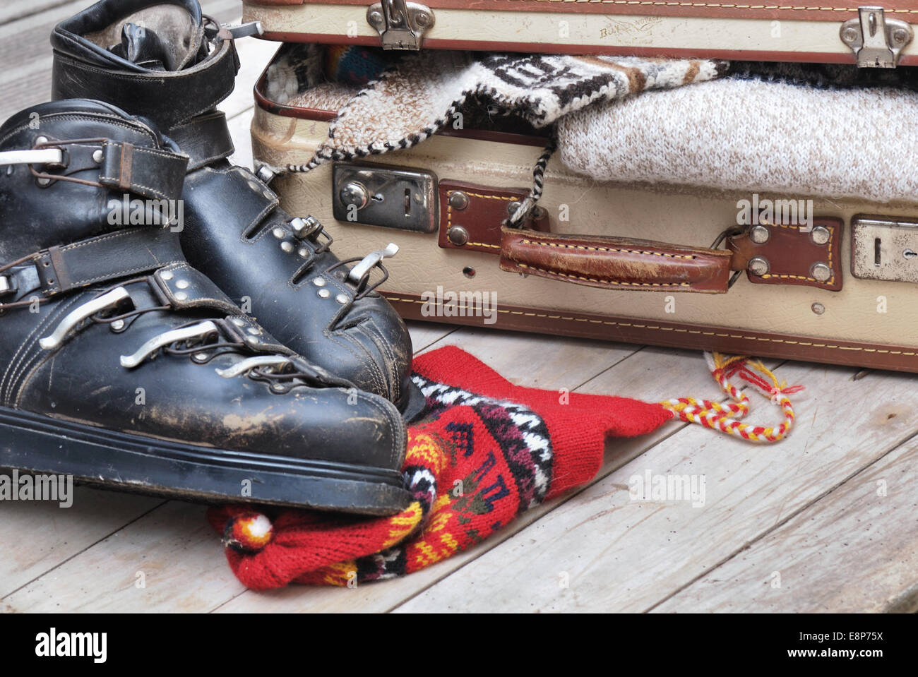 0c08f91f9f9 small open suitcase full of warm clothes with old ski boots Stock ...