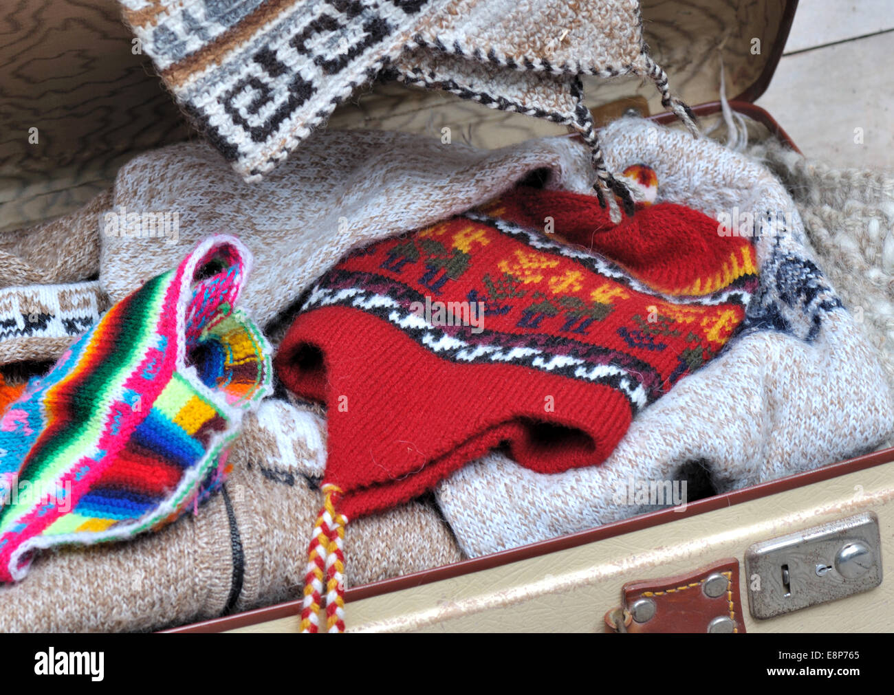 ea219f9627a small open suitcase full of warm clothes Stock Photo  74247325 - Alamy