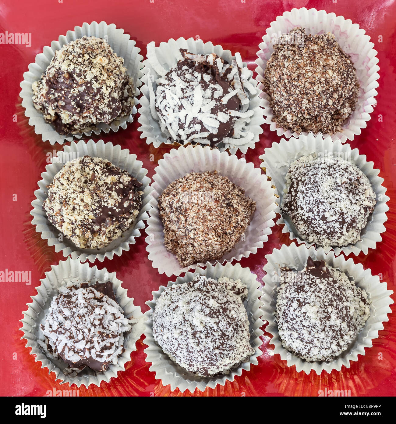 Homemade chocolate truffles with different coatings such as coconut, crushed almonds or hazelnuts or walnuts. Stock Photo