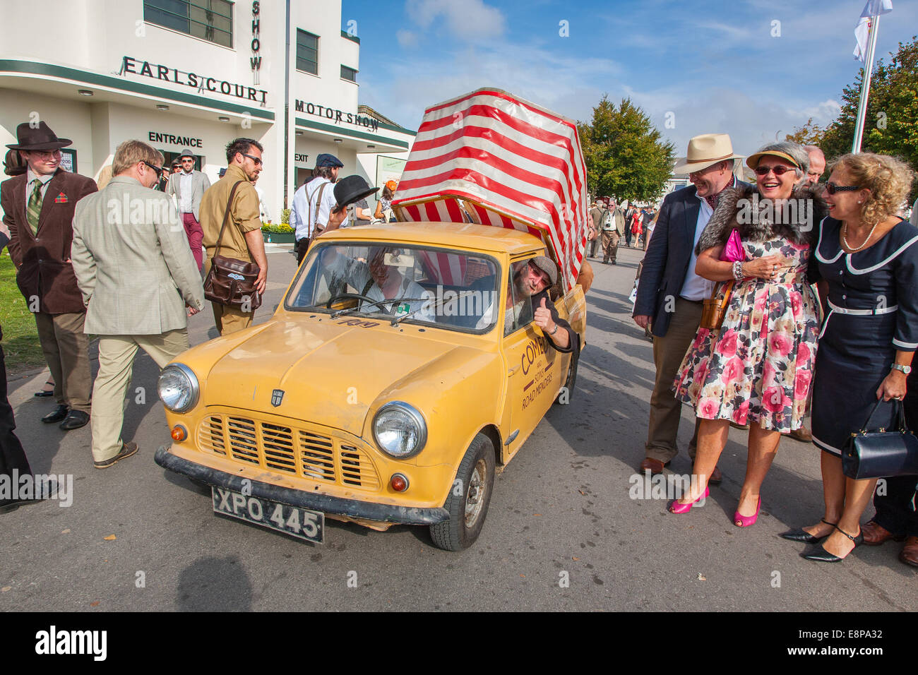 Workers in a vintage classic car Mini Van at the Goodwood Revival 2014, West Sussex, UK Stock Photo
