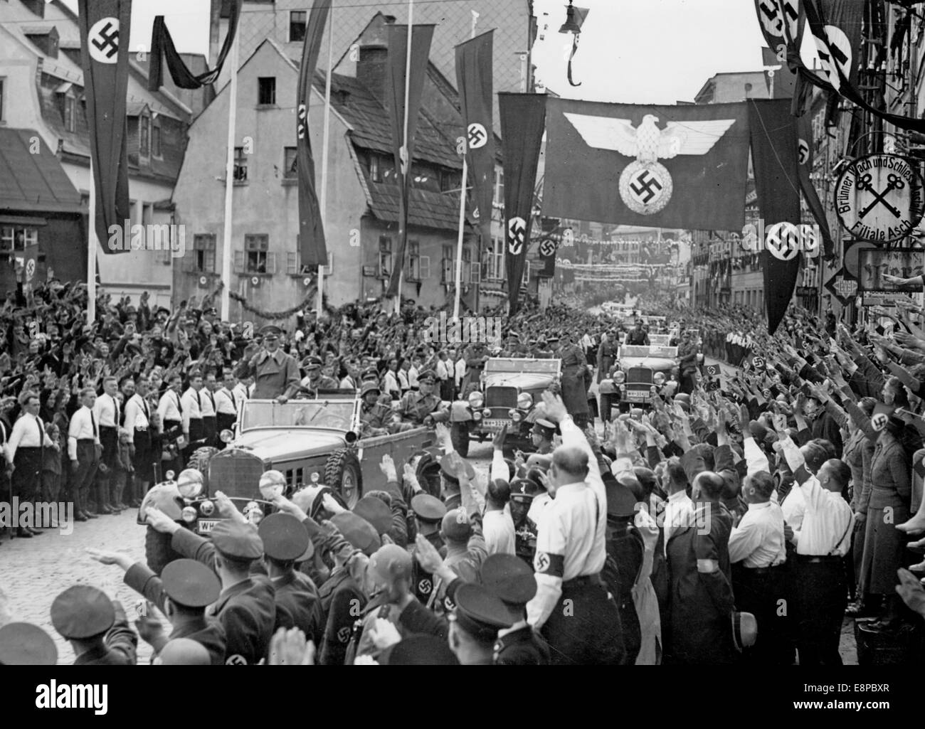 The photo from a Nazi news report shows three days after the Munich Agreement, Adolf Hitler rides into the town - Stock Image