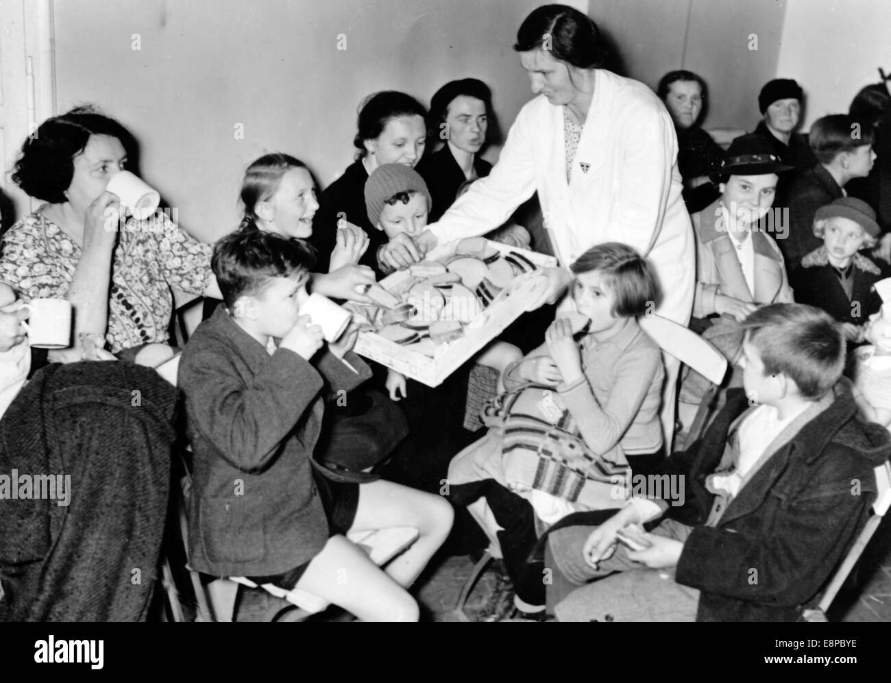 The picture from a Nazi news report shows Sudeten German refugees who fled from Czechoslovakia in the waiting room - Stock Image