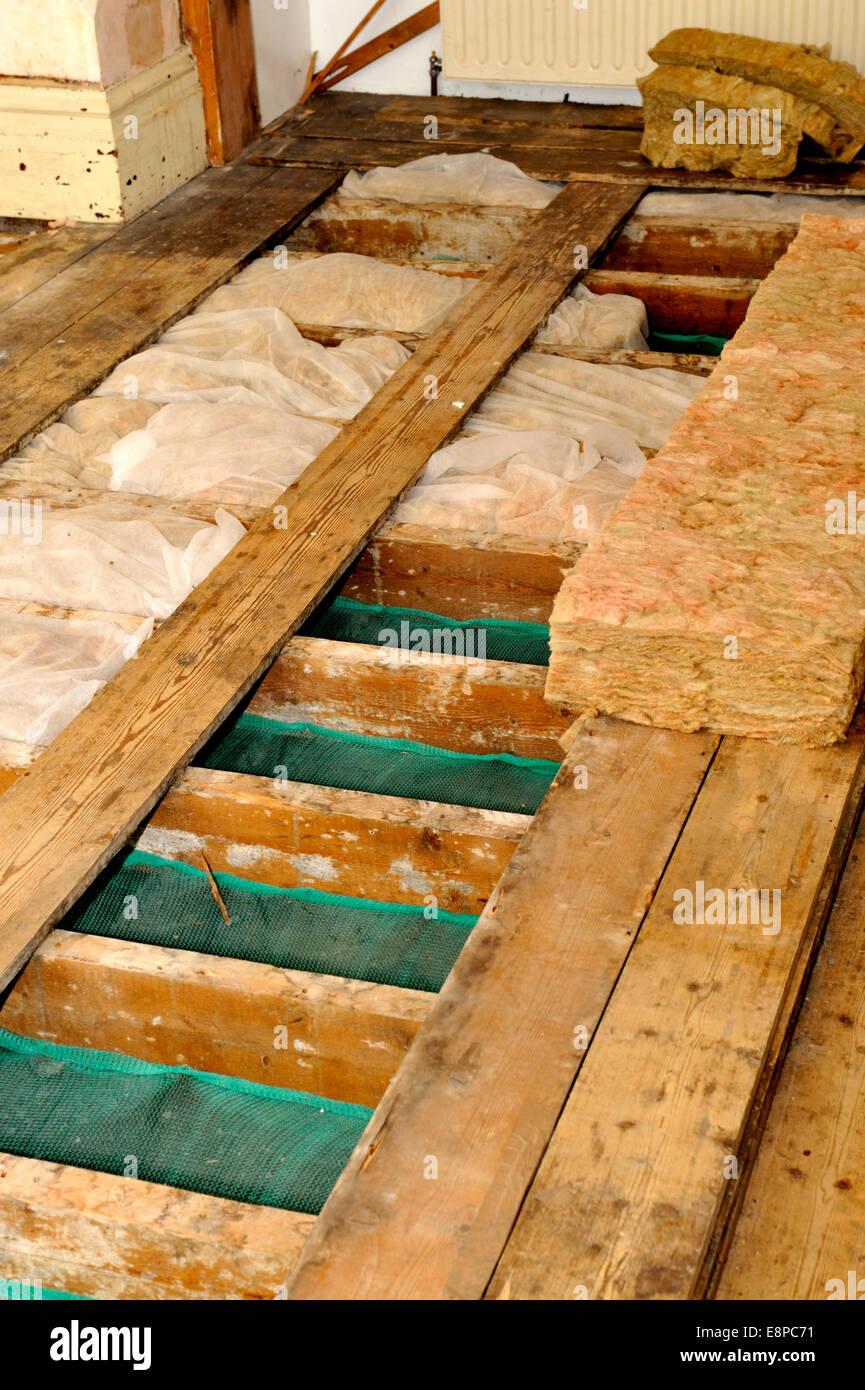 Underfloor Insulation Being Installed Over Netting On