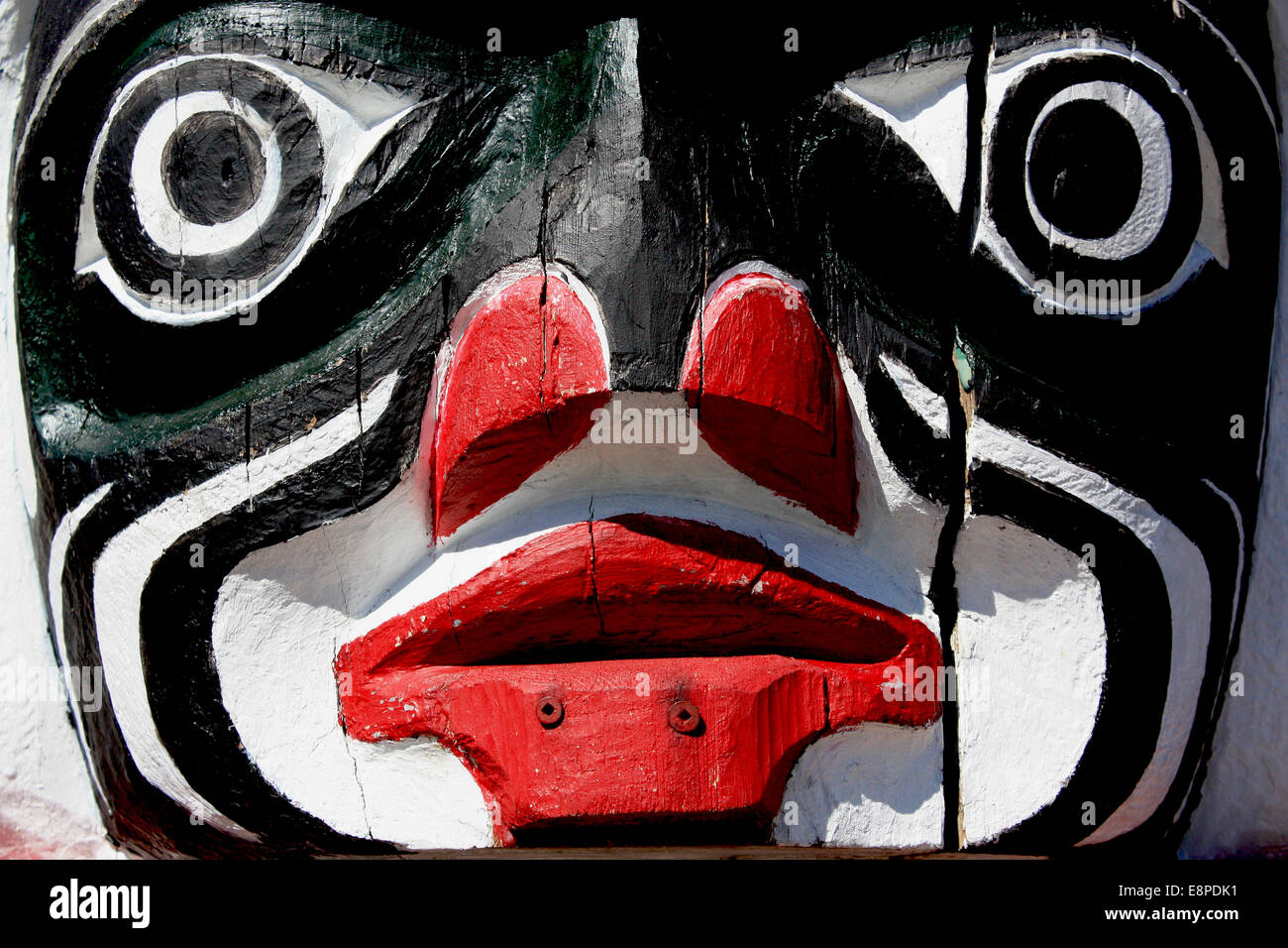 Face Carved in Totem Pole - Stock Image