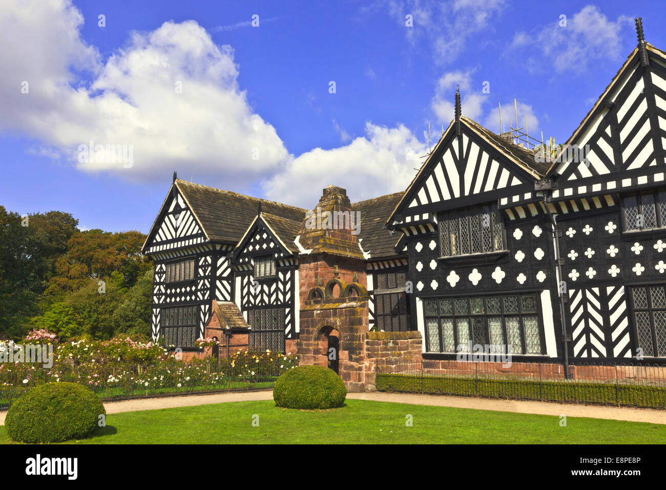 Black and white timber framed medieval mansion house and gardens. - Stock Image