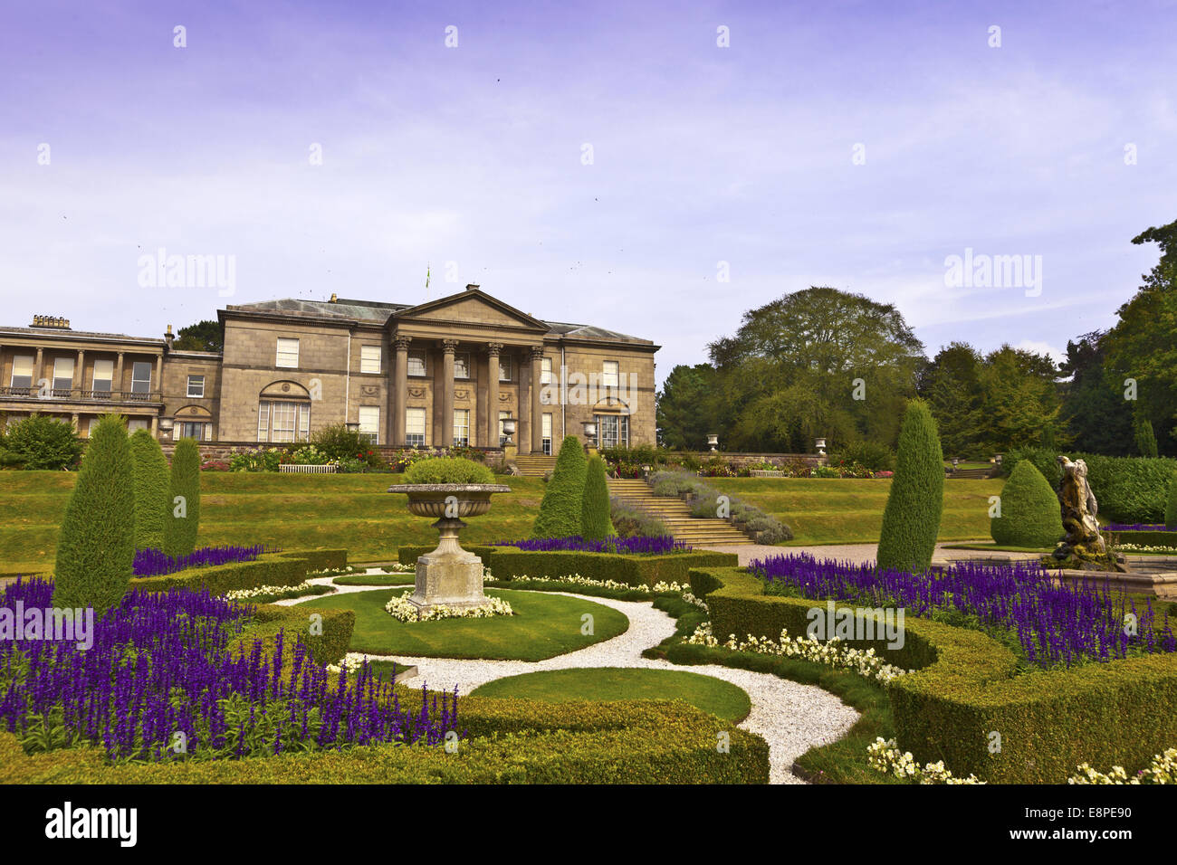 English landscaped garden and an historic neoclassical mansion. - Stock Image