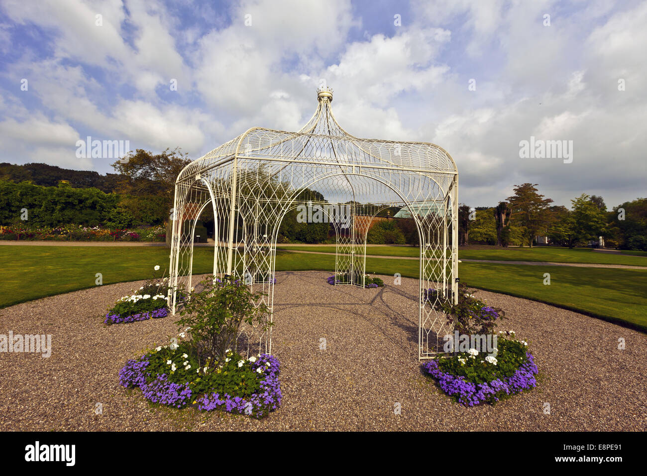 Wrought iron arbor in a landscaped park. - Stock Image