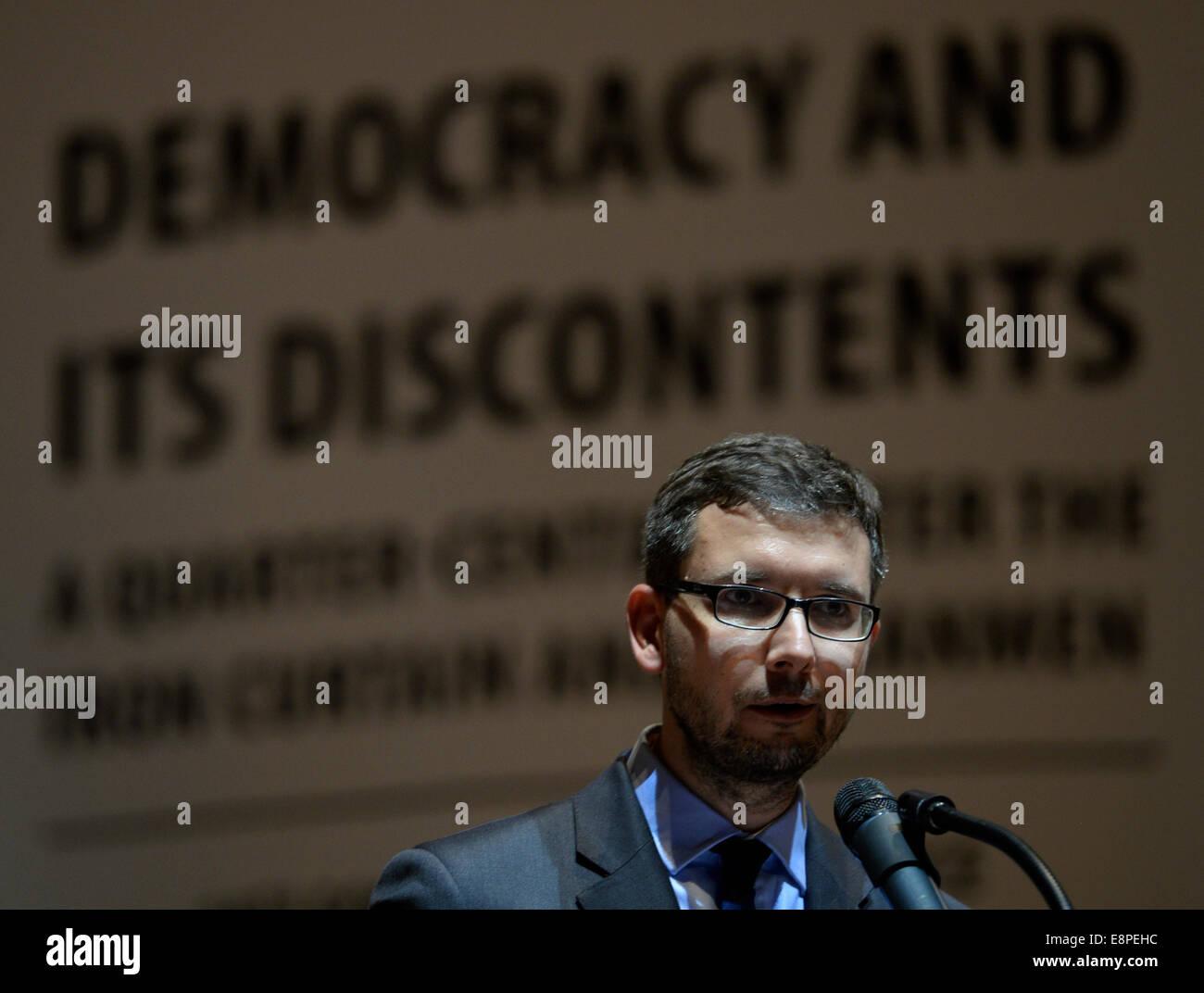 Prague, Czech Republic. 12th Oct, 2014. Executive Director of the Forum 2000 Foundation Jakub Klepal speaks during Stock Photo