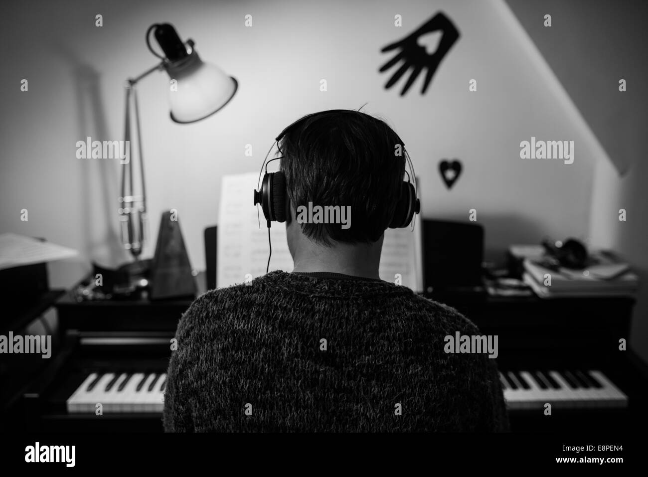 Learning to play the Piano - Stock Image