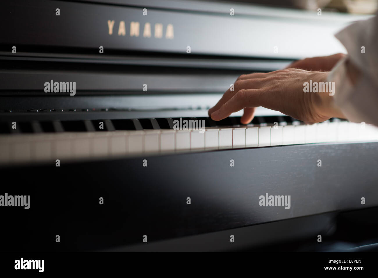 Playing the Piano - Stock Image