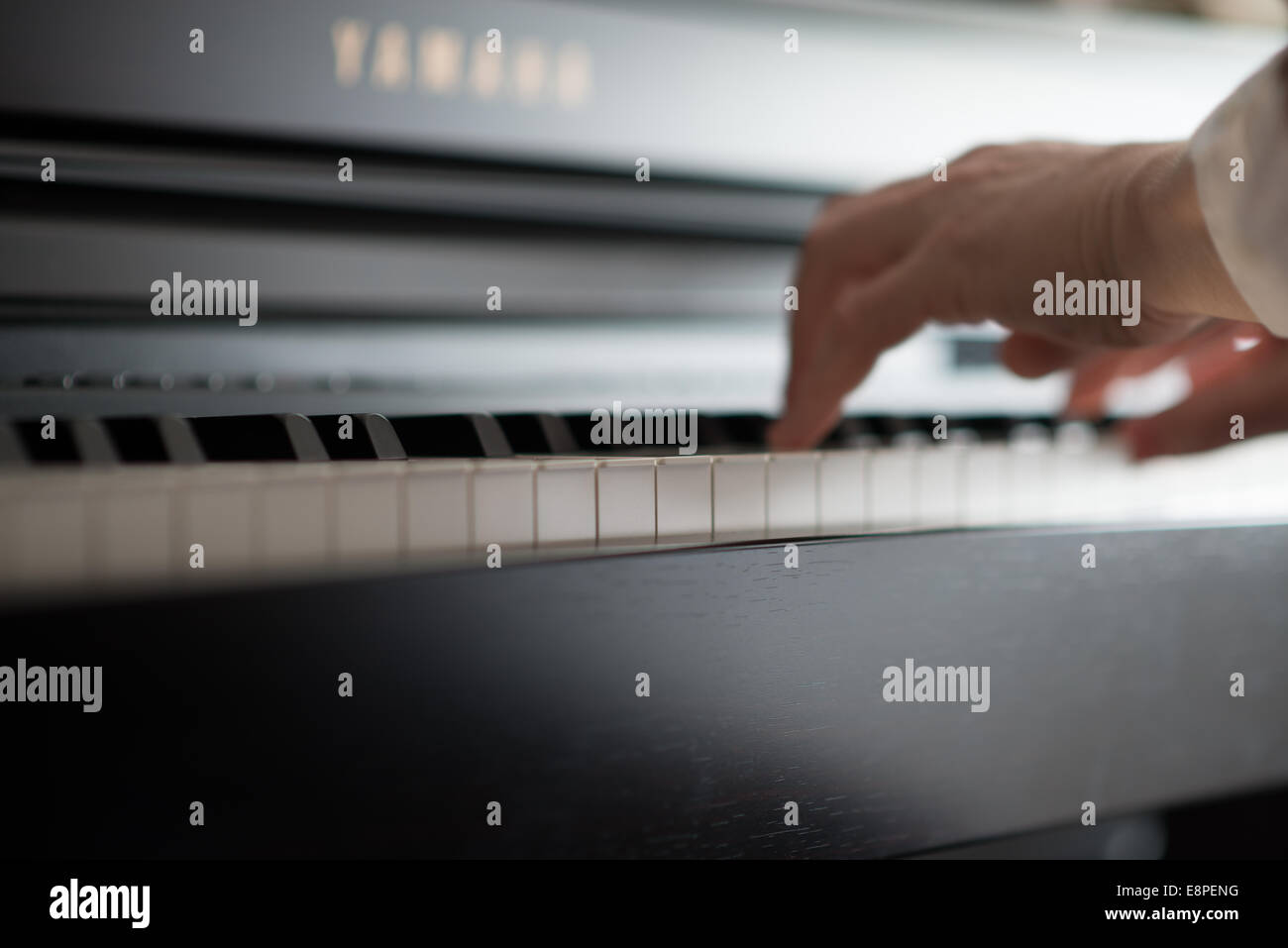 Practice and learn Piano - Stock Image