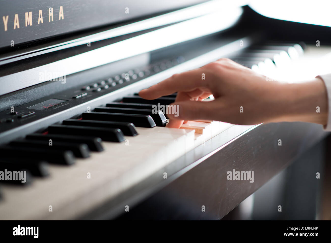 Practicing and learning Piano - Stock Image