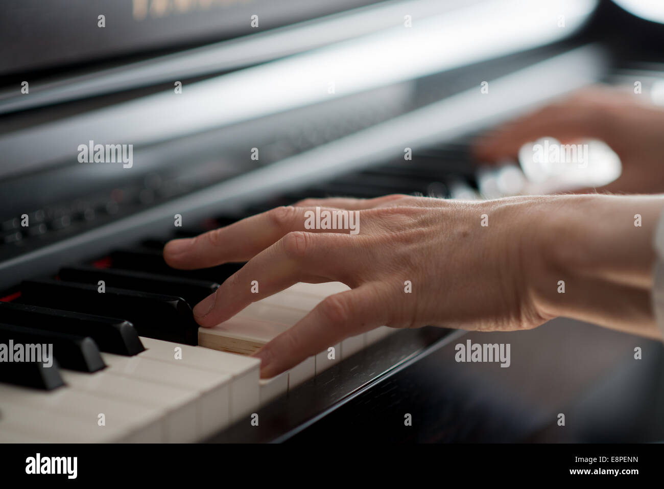 Detail of finger positioning - Playing and learning Piano - Stock Image