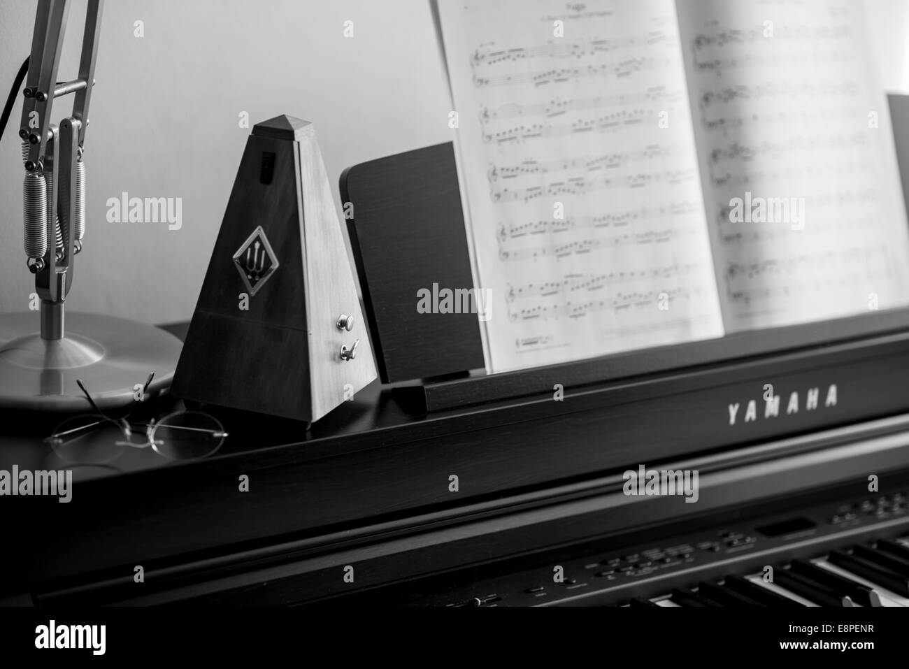 Metronome on Piano - learning a musical instrument - Stock Image