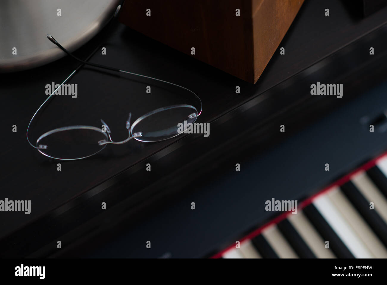 Glasses on Piano - Stock Image