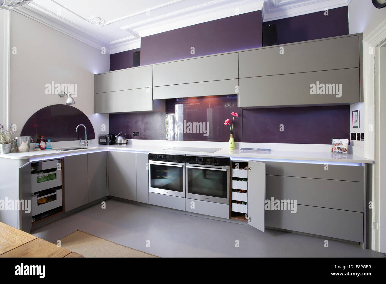 A Modern Kitchen Inside A Home In The Uk With Cupboard Doors Open Stock Photo Alamy