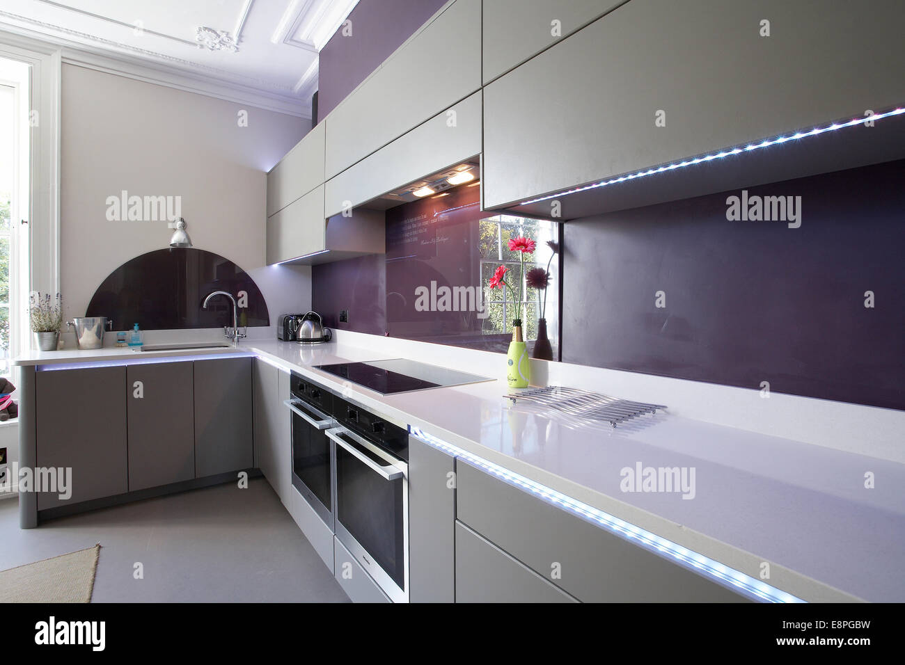 A modern kitchen inside a home in the UK. - Stock Image