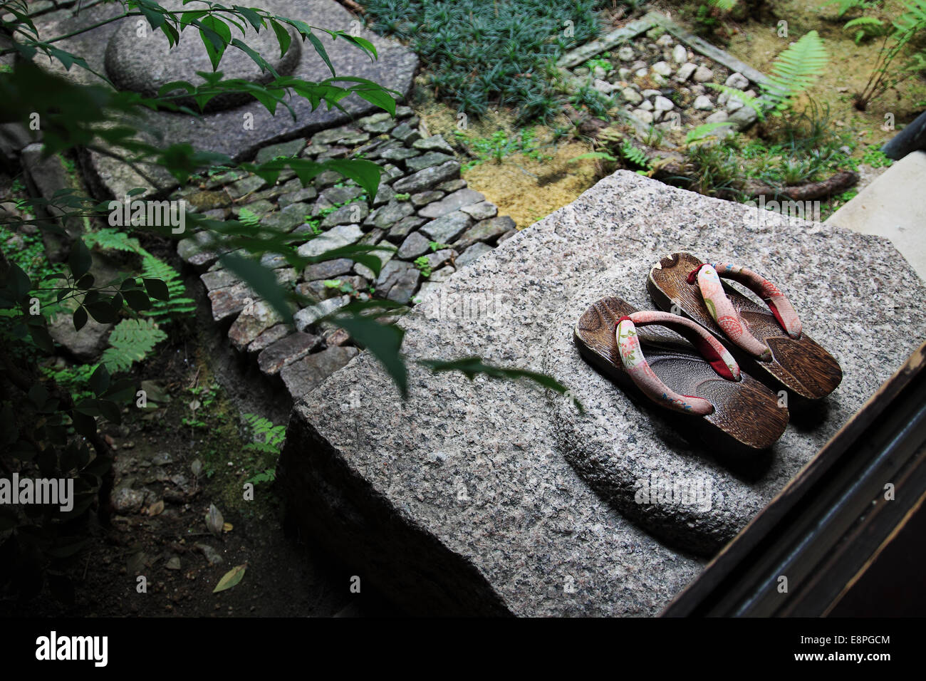 Zori sandals at a Tsubo-niwa (courtyard garden) in Nara, Japan. - Stock Image