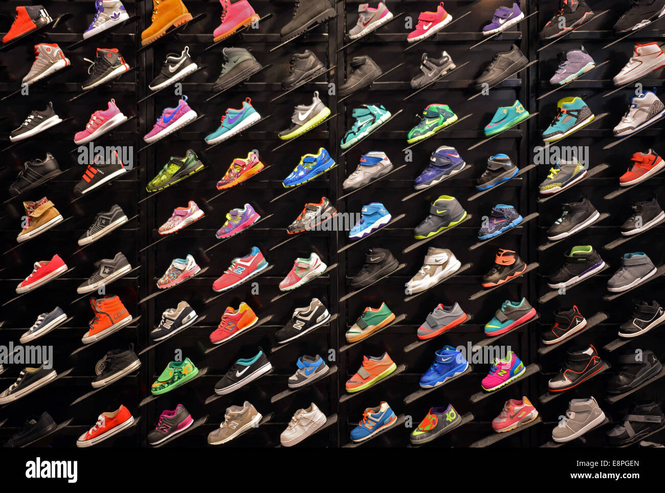 Colorful display of children's athletic shoes at Foot