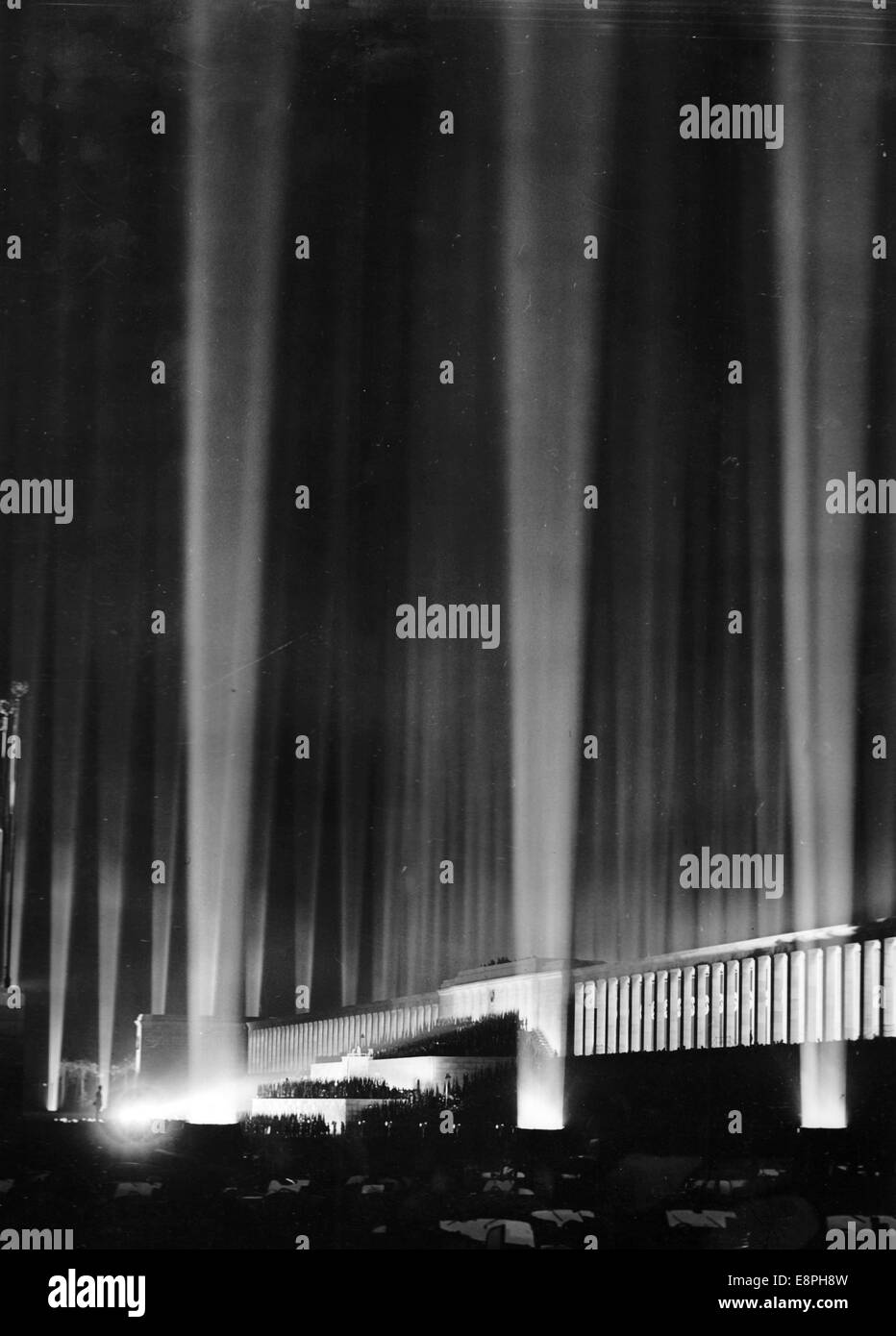 Nuremberg Rally 1936 in Nuremberg, Germany - Hundreds of searchlights flare up and illuminate the night sky after - Stock Image
