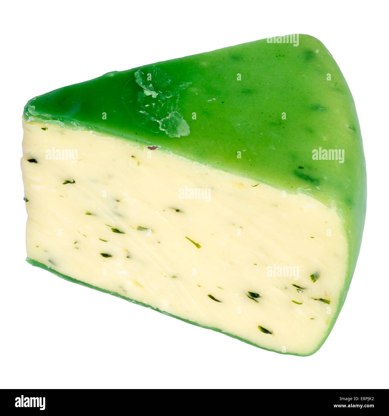 Wedge of Cheddar cheese & chives, cut out or isolated against a white background. Cheese sealed with green wax. - Stock Image