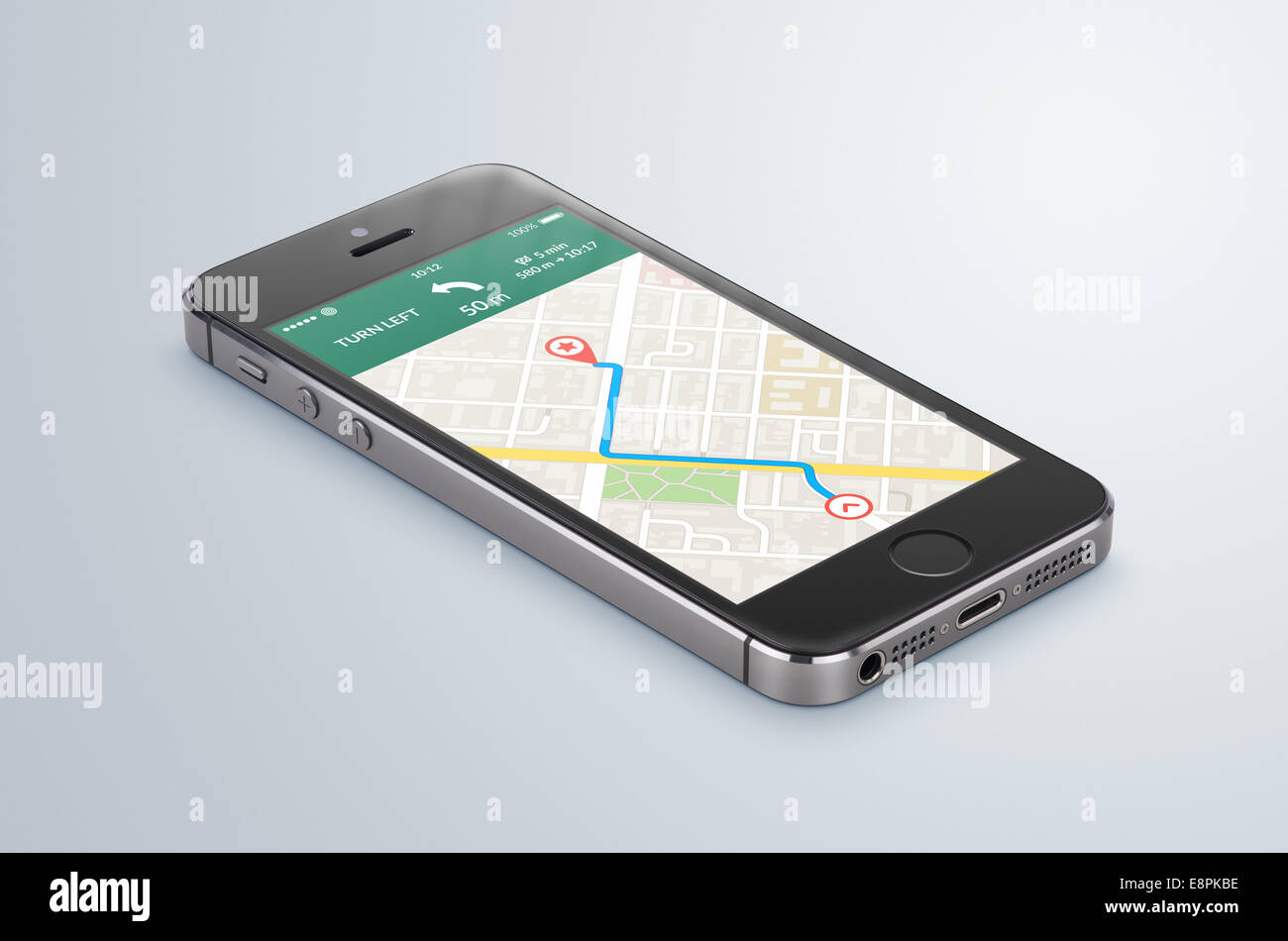 Black modern smartphone with map gps navigation application with planned route on the screen lies on the gray surface. - Stock Image