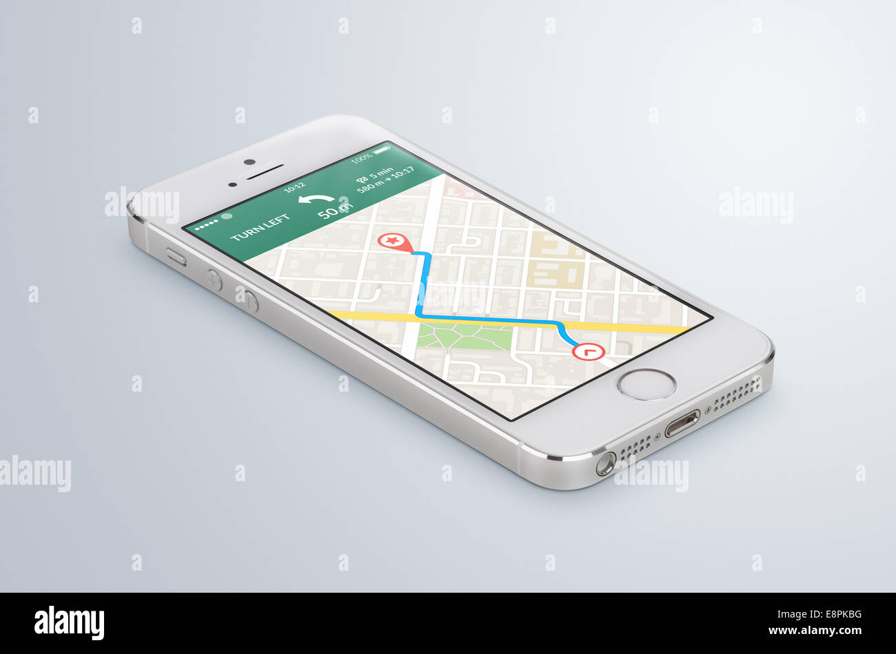 White modern smartphone with map gps navigation application with planned route on the screen lies on the gray surface. - Stock Image